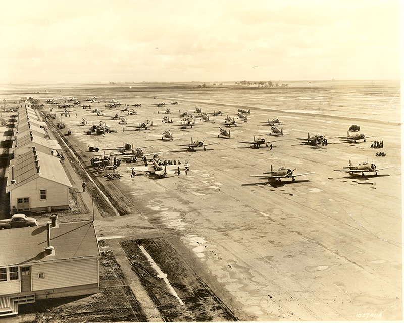 an old black and white photo of an airfield