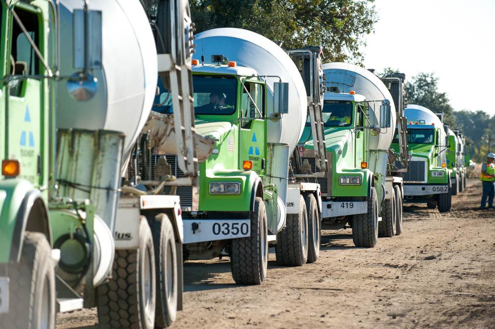 an image of a fleet of Teichert cement trucks driving to a job site