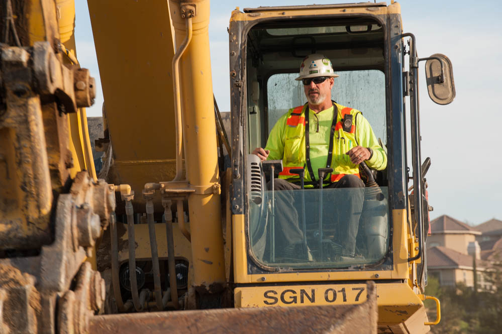 an image of a Teichert employee on a backhoe