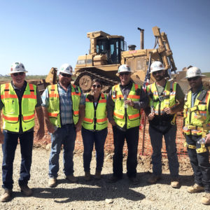 teichert team standing in front of tractor